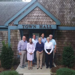 the picture is of the seven Town of Henlopen Acres Commissioners in front of Town Hall